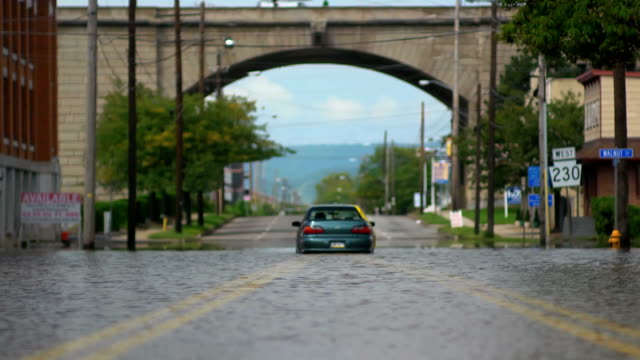 Flooded Car Under Arch - Wide Shot