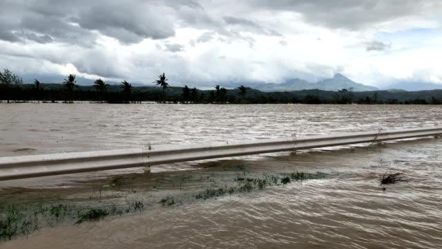 vídeos de stock e filmes b-roll de flooded farmland after typhoon kammuri makes landfall dropping heavy rain - filipinas
