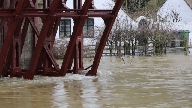 flooded houses in ironbridge in shropshire, where the river severn was in severe flood conditions after the wettest february on record in the uk,... - ironbridge shropshire stock videos & royalty-free footage