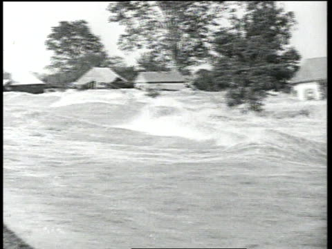 Flooded Mississippi River rushes through farm area / Arkansas United States
