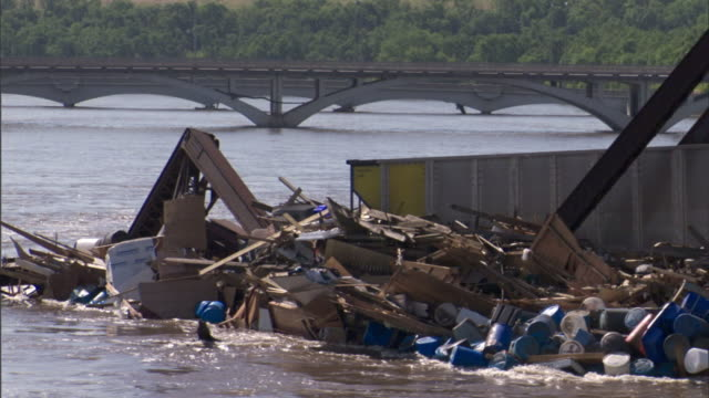 a flooded river washes around rubble. - rubble stock videos and b-roll footage
