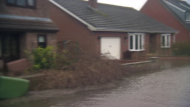 a flooded road in east cowick - riverbank stock videos & royalty-free footage