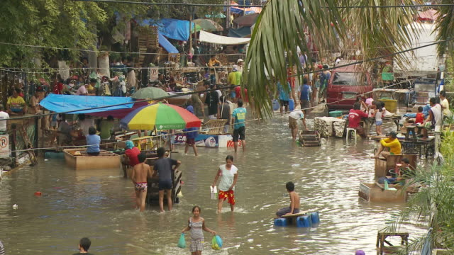 flooded street in manila philippines - flood stock videos & royalty-free footage