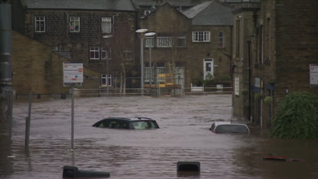 flooded streets in the calder valley after storm ciara - storm stock videos & royalty-free footage