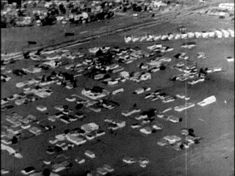 AERIAL flooded suburbs in Southern California / houses submerged in water Flooded suburbs in Southern California on April 01 1938 in California