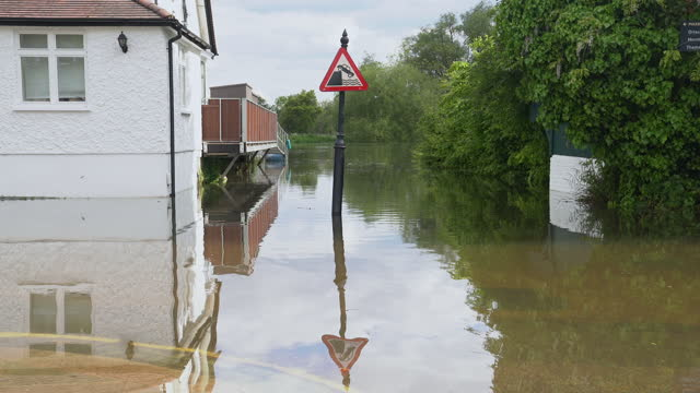 flooded thames river and warning sign - flood stock videos & royalty-free footage