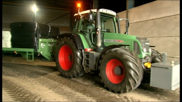 16 severe flood warnings across country yorkshire wakefield tractor carrying farming supplies on trailer along 'thank you for backing british... - hay truck stock videos & royalty-free footage
