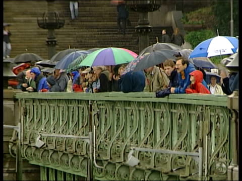 flooding acorss europe itn i/c gvs people standing on bridge as flood water passing below people looking at flood water vox pops local people sot gvs... - 2002 stock-videos und b-roll-filmmaterial