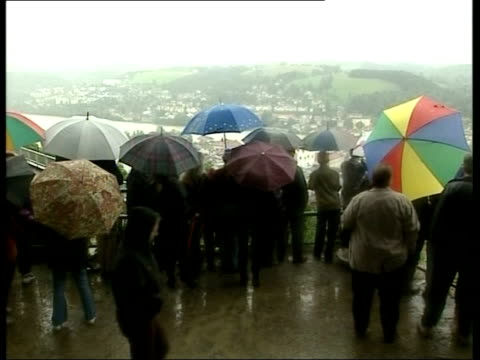 flooding acorss europe itn residents standing on high ground looking at flood - 2002 stock-videos und b-roll-filmmaterial