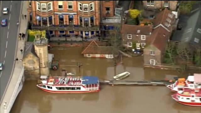 flooding across england and wales; air view flooded river ouse in york city centre air view flooded fields air view emergency service vehicles next... - river ouse stock videos & royalty-free footage