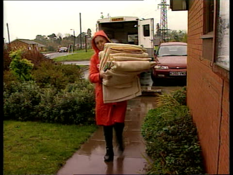 Flooding across England and Wales ENGLAND Worcestershire Bewdley DAY MS Red Cross workers into emergency accommodation centre carrying mattress and...