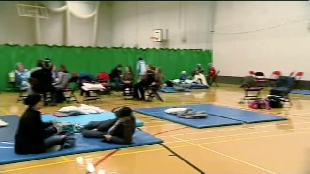 denbighshire st asaph int various of evacuated residents sitting on chairs and makeshift beds in emergency refuge centre in local leisure centre... - makeshift stock videos & royalty-free footage