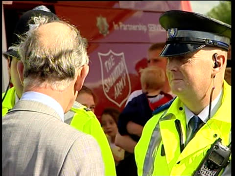 flooding across northern england: aftermath: prince charles visits catcliffe; prince charles talking to police and nhs paramedics / view on digital... - digitalkamera bildschirm stock-videos und b-roll-filmmaterial