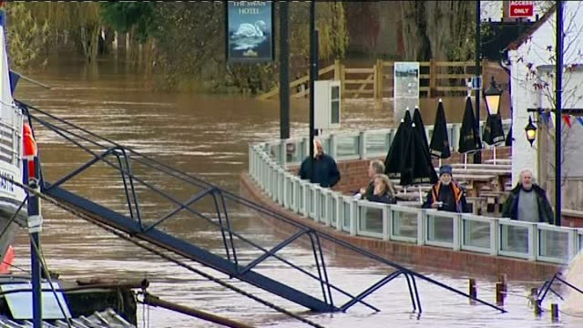 flooding across south west and northern england england worcester upton upon severn ext gvs flood water being pumped into river severn by new flood... - publican stock videos & royalty-free footage