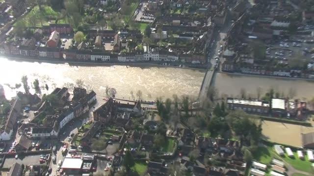 flooding aerials - ironbridge and bewdley; england: shropshire: bewdley: ext air views flooding in shropshire / failed pumps / reinforced defences... - ironbridge shropshire stock videos & royalty-free footage