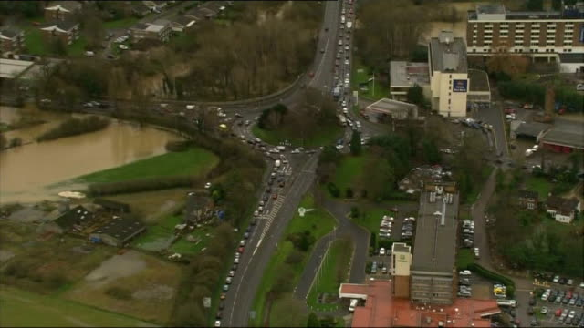 vídeos de stock, filmes e b-roll de aerials of sussex and surrey; england: west sussex: ext air views flooded countryside at redhill / planes on tarmac at gatwick airport / flooded area... - major road