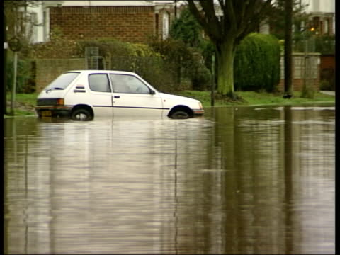 kent east peckham ext little girls along through flood water on rubber dinghy pull gv car partly submerged in flood water children wading through... - 2002 stock-videos und b-roll-filmmaterial