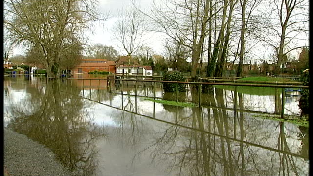 areas still at risk from rising river levels; surrey: sunbury-on-thames: int reporter and local resident caroline simpson down the stairs of her home... - surrounding stock videos & royalty-free footage