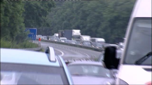 flooding as torrential rain hits uk; england: herefordshire: traffic jam on m50 motorway - herefordshire bildbanksvideor och videomaterial från bakom kulisserna