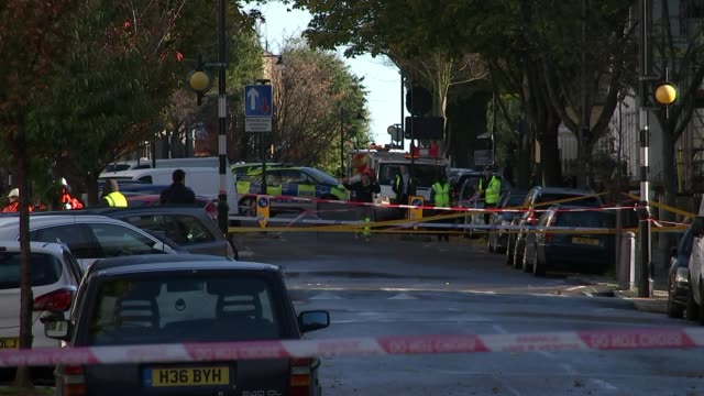 flooding caused by burst water main in islington; england: london: islington: ext sign 'road closed' in middle of road various shots of cordoned-off... - road closed englisches verkehrsschild stock-videos und b-roll-filmmaterial
