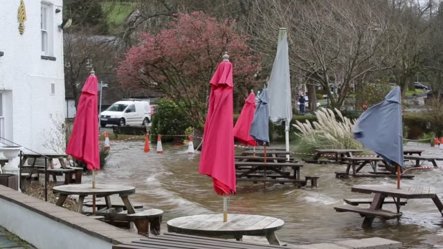 flooding caused by storm ciara at lake windermere in ambleside, lake district, uk with the wateredge hotel beer garden underwater. - river stock videos & royalty-free footage