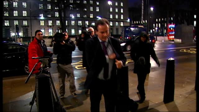 cobra meeting arrivals england london whitehall cabinet office unidentified man arrives at cabinet office / owen paterson mp arriving at cabinet... - オーウェン・パターソン点の映像素材/bロール