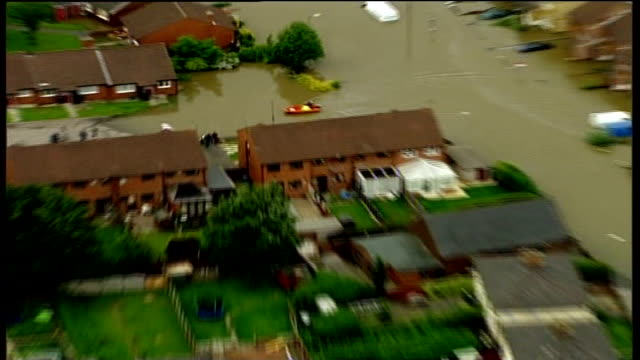 flooding continues across northern england air view submerged homes and gardens inflatable rescue boat along up flooded street in residential area... - sheffield stock videos & royalty-free footage