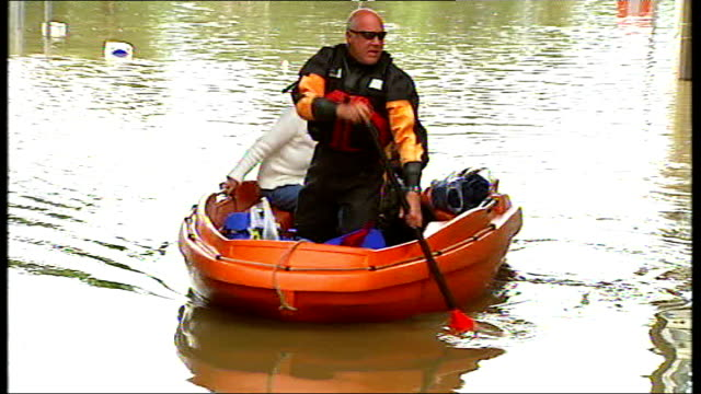 flooding continues across northern england england south yorkshire rotherham catcliffe ext sandra rogerson and her dog being rowed in rescue dinghy... - publican stock videos & royalty-free footage