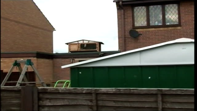 flooding continues across northern england ext flooded gardens with submerged sheds and garden furniture track rabbit in hutch on top of shed... - court room点の映像素材/bロール