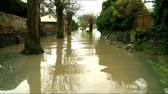 flooding continues in south and south west england army join relief effort / thames homes evacuated england gloucestershire tewkesbury floodwater... - gloucestershire stock videos and b-roll footage