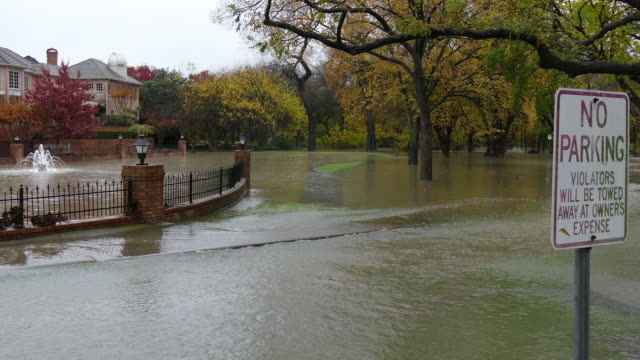 flooding creek overflows road past no parking sign dallas texas suburb - no parking sign stock videos & royalty-free footage