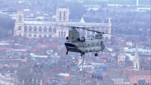 David Cameron visits Yorkshire / government flood policy questioned AIR VIEWS / AERIALS RAF Chinook helicopter flies over flooded area of York York...