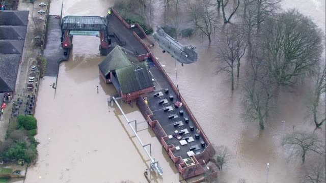 David Cameron visits Yorkshire / government flood policy questioned ENGLAND Yorkshire York VIEWs / AERIALs RAF Chinook helicopter flies over flooded...