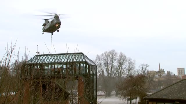 vídeos de stock e filmes b-roll de david cameron visits yorkshire / government flood policy questioned chinook helicopter lowering repair equipment to flooded foss barrier pumping... - baixar