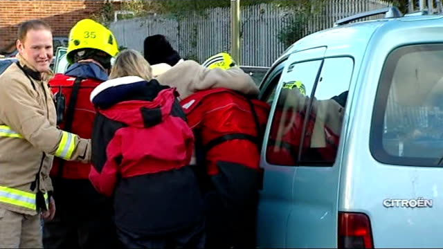 Elderly people rescued from homes in Staines ENGLAND Surrey Staines INT People being evacuated from their homes in van / flooded road / elderly...