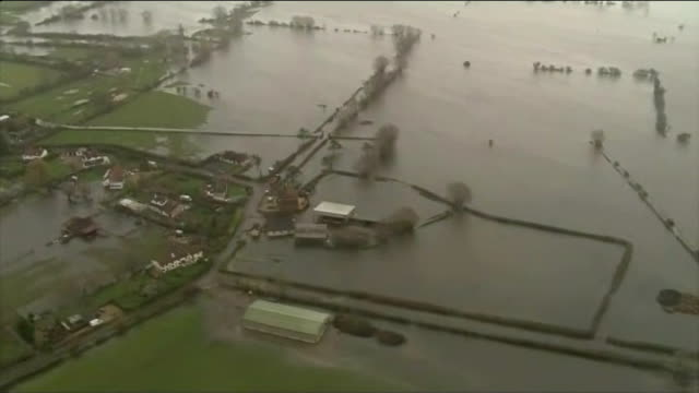 environment agency can't afford to protect both towns and country lib / tx air view / aerial flooded landscape in somerset levels end lib - somerset levels stock videos and b-roll footage