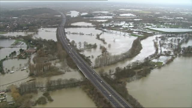 groundwater levels could keep rising until spring england motorway along above flooded surrounding countryside - groundwater stock videos and b-roll footage
