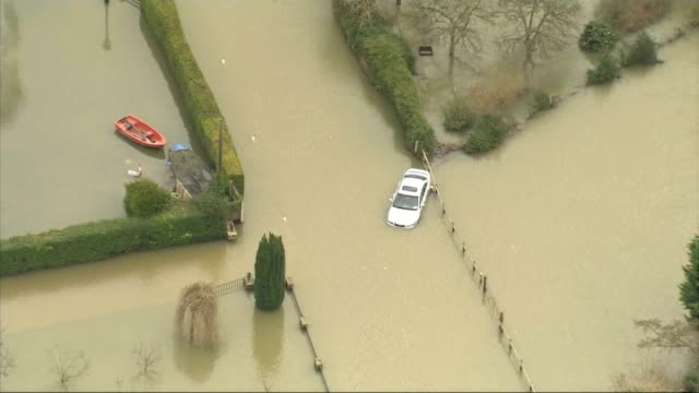 groundwater levels could keep rising until spring **macdonald interview overlaid sot** partially submerged car on flooded road - groundwater stock videos and b-roll footage