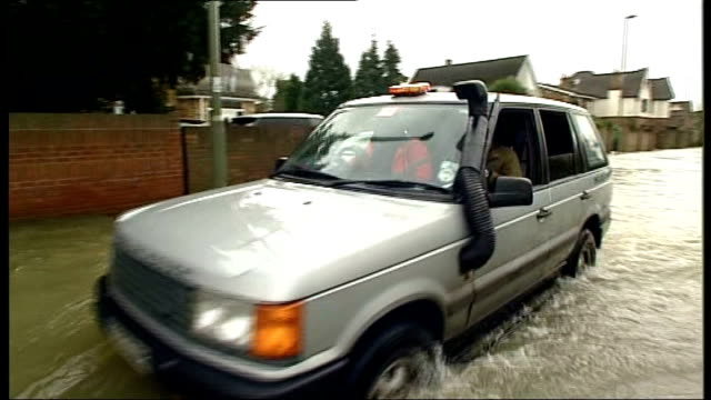 groundwater levels could keep rising until spring range rover car along flooded road - groundwater stock videos and b-roll footage