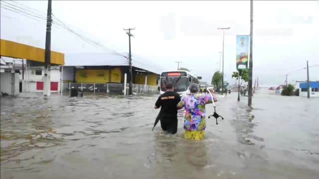 vídeos de stock, filmes e b-roll de flooding hit the northeastern brazilian city of recife where the usas crunch world cup game against germany was taking place on thursday blocking... - bloquear