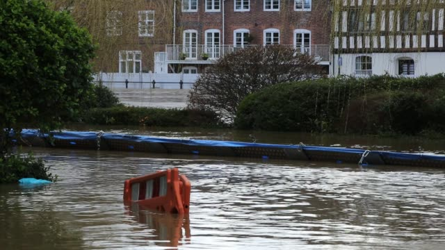 flooding in bewdley, worcestershire, when the river severn broke its banks and over topped the flood barriers, after the wettest february on record... - town stock videos & royalty-free footage