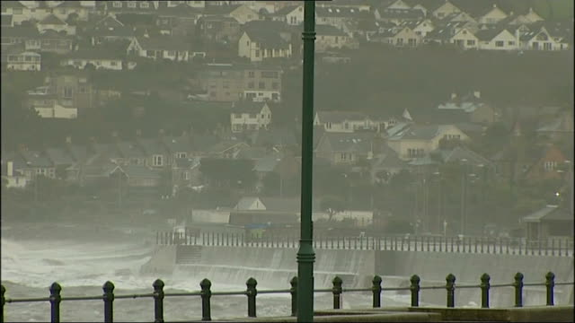 flooding in cornwall and devon; cornwall: penzance: sign 'road closed' and police car along near seafront / waves crashing against sea wall and water... - road closed englisches verkehrsschild stock-videos und b-roll-filmmaterial
