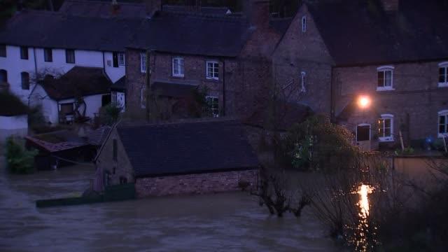 flooding in ironbridge, shropshire; england: shropshire: ironbridge: ext / dusk gvs flooding in ironbridge - ironbridge shropshire stock videos & royalty-free footage