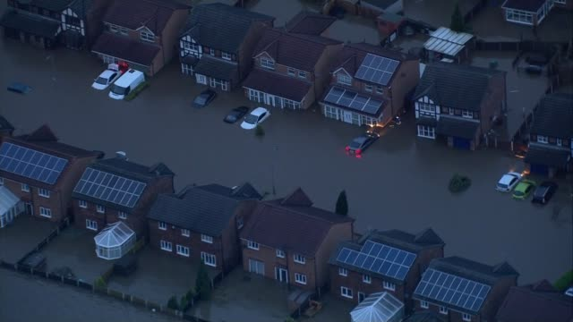 Greater Manchester Rochdale Flooded area showing flooded houses and partially submerged cars