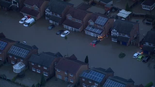 greater manchester rochdale flooded area showing flooded houses and partially submerged cars air view flooded town centre - rochdale england stock videos & royalty-free footage