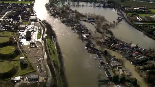 flooding in thames valley; england: thames valley: ext air views - aerials of flooded river thames and surrounding area - surrounding stock videos & royalty-free footage