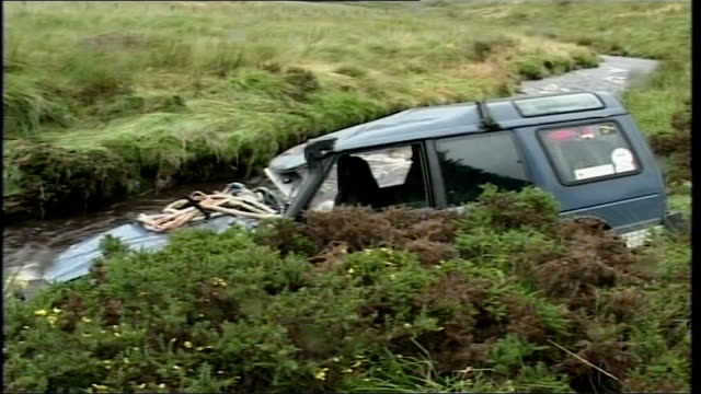 17yearold girl dies after car overturns wales powys ext various of fourwheel drive vehicle in which a 17yearold girl was trapped when it plunged into... - powys stock videos & royalty-free footage