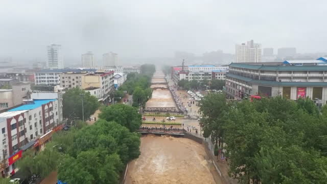 """flooding in zhengzhou, eastern china, after the heaviest rainfall on record - """"bbc news"""" stock videos & royalty-free footage"""
