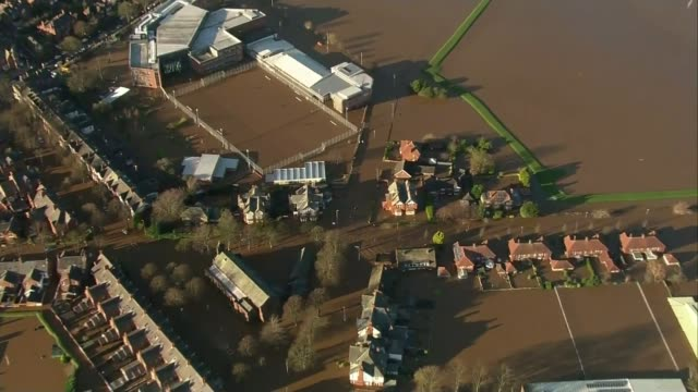 stockvideo's en b-roll-footage met natural flood protection project in north yorkshire; lib cumbria: air views flooded houses in residential area end lib - channel 4 news