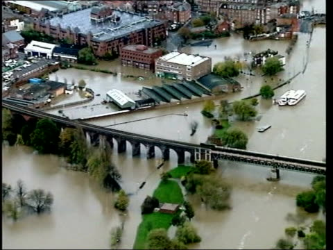new report recommends more investment on flood prevention lib air views flooding flooded playpark lorry stuck on flooded road flooded shops man... - prevention stock videos & royalty-free footage
